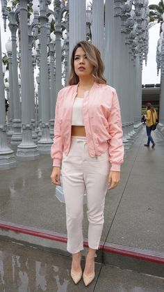 Take any of your outfits up a notch by throwing on this pastel pink bomber jacket. Wear it over a t-shirt and jeans or over a dress. Guaranteed to get you compliments. Solid long sleeve bomber style j