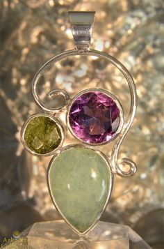 Aquamarine, Amethyst, and Moldavite Sterling Pendant | Arkadian Collection Using a lyrical design ,this healing Jewelry is entirely one-of-a-kind. Moldavite, Amethyst and Aquamarine possess metaphysical properties which protect, deepen intuition, and focus the soul on higher purpose.  This powerful trio works together to create wonderful high energy transformation and enhanced intuition.