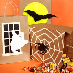 Martha crafts adorable trick-or-treat bags decorated with ghosts, spiders, and bats.