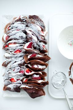 Chocolate crepes with strawberries & cream.