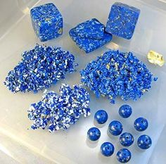 Create faux lapis with polymer clay in various shades of blue, translucent clay and composition gold leaf (not real gold!)