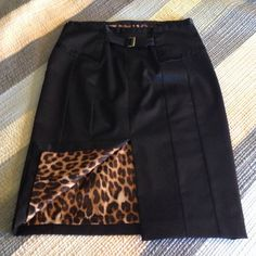 """Black Express Pencil Skirt Reposh. Size tag is missing. Seller assured me it was a 10 but it does not fit. It is probably an 8. Waist is 15"""", 24"""" long. It's a quality piece. Fully lined with a fun leopard print. Express Skirts Pencil"""