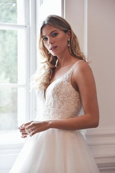Hand-beaded glitter tulle wedding dress with glistening pearls and a lace bodice with a sexy plunge front neckline. Corset Back Wedding Dress, Luxury Wedding Dress, Tulle Wedding, Designer Wedding Dresses, Bridal Dresses, True Bride, Unusual Dresses, Bride Look, Ball Gowns