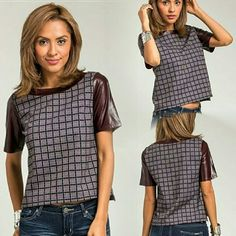 Burgundy faux leather sleeve top Checkered pattern, short sleeve, belt line length.   Small, medium, large available.   * Please do not purchase this listing. Let me know which size you need and I will create a personal listing for you to purchase. Thanks ladies! swynnboutique Tops
