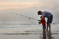 First fishing lesson. Grandson and Grandaddy in Corolla. Wind Wave Water Fun. Carrie M