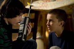 Millie Bobby Brown and Finn Wolfhard in Stranger Things (2016)