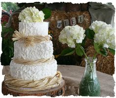 Simple buttercream cakes, adorned with natural items like fresh flowers and raffia, continue to be in demand for outdoor weddings. #blissmcdonough #blisscakes #rusticweddingcake #countryweddingcake #buttercreamweddingcake