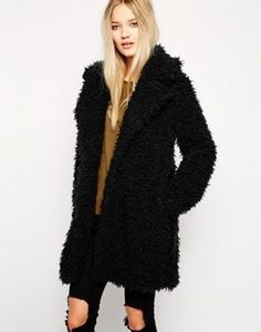 The black #fluffy fabric and beautiful shape of this lush ...