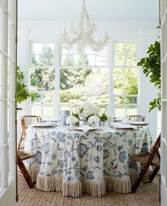 Aerin Lauder Dining Room Blue And White Skirted Table Bullion Fringe White  Coral Chandelier Bamboo Folding Chairs