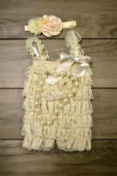 Check out this item in my Etsy shop https://www.etsy.com/listing/205804202/vintage-cream-lace-petti-romper-w