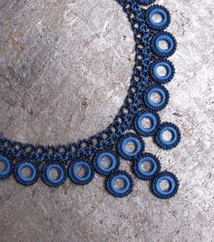 Our most Chic & Unique Collection of Hand Crocheted Jewelry The Blue Chic Crochet Necklace has an elegant tone to blend with any skin tone, and the navy blue beads make it pop. Stunning colors & delic