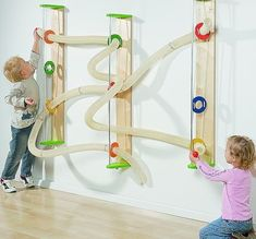 Wall mounted ball run. This would be great for kids who are too young for the marble runs. A small, simple version of this could maybe be fun somewhere? Toddler Activities, Activities For Kids, Kids Crafts, Sensory Wall, Sensory Toys, Sensory Boards, Indoor Playground, Preschool Playground, Playground Ideas