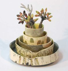 Ceramics by Anna Lambert at Studiopottery.co.uk - 2014. Cononley edge with bilberry and heather spoons: bowl stack height 23 x diameter 18cm. £400. Slab built from a white earthenware mixed clay, with stamped, impressed, modelled and stencilled details, inlaid or painted slips and underglaze painting. The pieces are finished in a transparent lead based glaze.