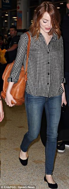 Preppy and casual, Emma Stone gets it right in classic black and white. Take your versatile gingham shirt and pair it with your go-to denim and simple flats. Great travel style!