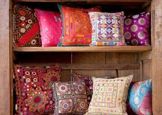 Display throw pillows on shelves. This is way cooler than keeping them in a chest, hidden away!