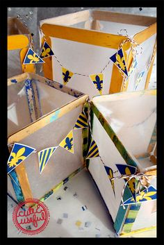 Blue and Gold Centerpieces (Cubs help make) + free mini-pennant printable.    http://www.cuteanduseful.com/content/2012/3/6/blue-and-gold-centerpieces-free-mini-pennant-printable.html