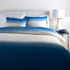 "The Surya Dip Dyed bedding set provides the perfect pop of color with a modern ombre design. This fun, two-toned ensemble delivers comfort and visual texture to a child's room. A cotton flax blend offers a soft and cozy feel. Twin: 68""W x 86""L. Full/Queen: 92""W x 88""L. King/CA King: 108""W x 92""L. Standard: 20""W x 26""L. Available in Navy and Raspberry. 80% cotton, 20% flax. Knife-edge. Duvet set includes duvet and 2 standard shams. Professi..."