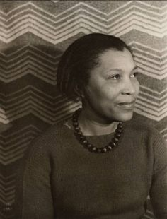 """Zora Neale Hurston, 1935, photo by Carl Van Vechten. """"But for the national welfare, it is urgent to realize that the minorities do think, and think about something other than the race problem."""" . . . """" Sometimes, I feel discriminated against, but it does not make me angry. It merely astonishes me. How can any deny themselves the pleasure of my company? It's beyond me."""" . . . """"Gods always behave like the people who make them."""" . . ."""