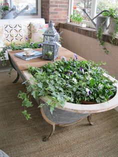 Old Bathtub turned coffee table/planter! via the Garage Sale Gal I actually have an old claw foot tub in my barn, I was thinking of making it into a small koi pond, but I think I like this coffee table/planter better for our vacation home. Garden Tub, Dream Garden, Garden Planters, Porch Planter, Herb Garden, Recycled Planters, Porch Garden, Outdoor Planters, Garden Cottage