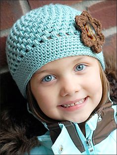 This Chloe Cap is perfect for young and old alike!     Instructions include flower and sizes to fit: baby (0-6 months), toddler (6-24 months), child (2-8 years), 9-teen, & adult. Made using sport weight yarn and H & G hooks or hooks needed to work to gauge.