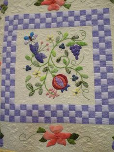 Gorgeous quilt with piecing and applique.  This site has more detailed pictures of the quilting, etc.