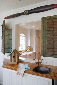 Cabinet covers made from old shutters. Very cool.