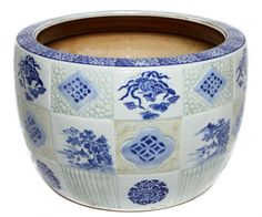Large blue and white Japanese porcelain hibachi with patchwork design depicting phoenix and tree motifs.