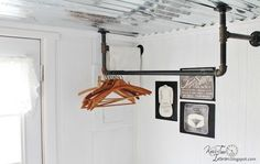 DIY Pipe Clothing Rack - Laundry Room Reveal - Pipe clothing rack attached to the ceiling. Would love this in my basement>