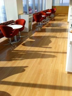 This custom, wood-grain sheet vinyl installation at the Comcast Center beautifully accents the space by making the room brighter by showcasing the natural light the space receives. Vinyl Flooring Installation, Office Floor, Luxury Vinyl Flooring, Hardwood Floors, Wood Flooring, Floor Design, Custom Wood, Natural Light, Interior And Exterior
