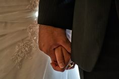 Bride and bridegroom hand by hand