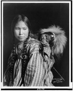 2014-04-10-14_1.jpg Madonna of the North. An Inuit woman with child. 1900. Alaska.