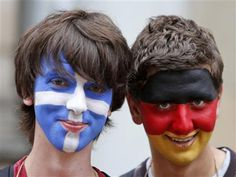 SOCCER FEVER!!!    Polish facepainting artists pose with Greek and German flags on their faces before the Euro 2012 soccer
