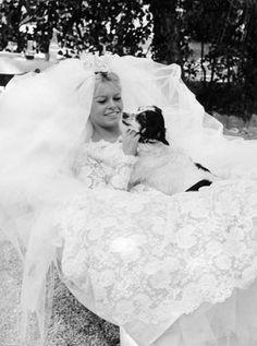 When: 1959   Where: On film in Come Dance with Me! (Voulez-vous danser avec moi?)   The Groom: Henri Vidal   The Dress: A romantic lace confection by Jacques Esterel, worn with a crown-topped veil