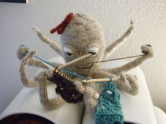 look how happy he is ! knitting and crochet at the same time :-)