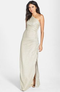 Free shipping and returns on Laundry by Shelli Segal Foiled One-Shoulder Gown at Nordstrom.com. A breathtaking one-shoulder gown is cut from a wavy-textured jacquard illuminated with a precious-metal shimmer. The sinuous silhouette gathers to one beaded side that gives way to a leg-baring slit with a gracefully scalloped finish.