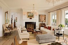 An English dog painting is set over the living room fireplace in Rob Lowe's Santa Barbara home, designed by David Phoenix, while a photograph by Lyndie Benson is above the Dutch secretary | archdigest.com