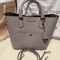 MK Greenwich Grey crossbody/tote Bag is in like new condition carried about a month.  Has one exterior slip pocket and one interior zipper pocket/slip.  Price is firm and no trades. Michael Kors Bags Crossbody Bags