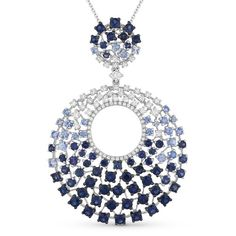 Staggered sizes and shades of blue sapphires set in concentric circles create an ombre effect in this bold yet elegant necklace in 14K white gold.  Ref# MAD-DN4670.  Goldex Fine Jewelry ~ (323) 726-7181.