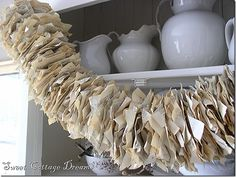 Old book pages garland! You could vary the width by how big you fold the pages.