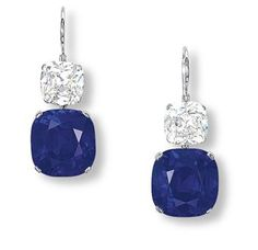 AN IMPORTANT PAIR OF SAPPHIRE AND DIAMOND EAR PENDANTS  Each set with a cushion-shaped sapphire weighing 17.25 and 15.09 carats, to the cushion-shaped diamond spacers weighing 3.23 and 3.23 carats, mounted in platinum, 3.4 cm long