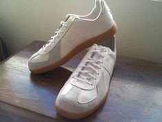 German Army Trainers (GAT). Sneakers without any logo or branding, used for decades by the German Bundeswehr for training indoors, now an icon available as military surplus. $50