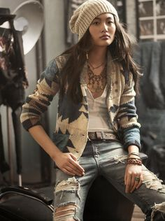 This outfit has such a funky, cool, casual vibe. The combo of the distressed jeans, wide leather belt, fitted tee, chunky sweater and boho statement necklace all work well together. Not my typical style, but I would totally rock this type of look in the fall/winter.