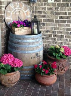 Wine barrel on porch. maybe something to do with the wine barrel I picked up at the dump? - My Sunny GardensWine barrel on porch. If I could find one that says Jack Daniels.Clock from wine barrel lidCreative ways to use wine barrels in your garden from ga
