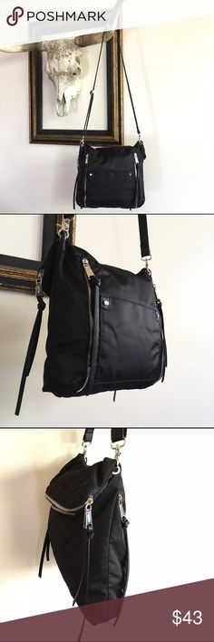 CO-LAB Vegan Nylon Crossbody Satchel CO-LAB Black Nylon Crossbody Satchel with Vegan Leather Accents. Slim profile. Interior & Exterior Pockets. Sturdy Zippers. Adjustable Shoulder Strap. Foldover Zip Closure. Top Flap Unfolds to Extend Bag Height; Perfect for Artist Sketchbooks, Prints, etc.  Made in Montreal. 100% Vegan.  Condition: Excellent/EUC, minor signs of wear on nylon at corner  Aproximate Dimensions Strap Length (drop): 25in; adjustable Bag Height (folded): 12.5in Bag Height…