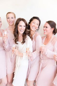 A stunning blush Omni Montelucia wedding. The bride wore her hair down with a cathedral veil and pearl and diamond earrings. Her dress had a v-back and pearl buttons. She carried a bouquet of pure white roses while the bridesmaids bouquets had touches of blush pink to match their blush pink dresses. The guys slate grey tuxedoes paired perfectly with the pink and white florals. And the ceremony and reception had touches of white and accents of gold throughout!