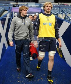 Jonny Gray - injured Scotland lock (L) strides down the tunnel with brother Richie after being ruled out of the Ireland 6 Nations match this weekend.<br /> Scotland rugby union training session, (pre-Ireland) Murrayfield Stadium, Edinburgh, Scotland, Sunday 13 March 2016.<br /> ***Please credit: David Gibson/Fotosport***