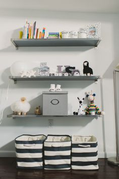 Baby chic! This modern fun nursery featured on Style Me Pretty features our Rugby Stripe Bins for added storage.