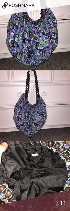 Blue Paisley Purse Adorable purse purchased from Tren-D at Disney Springs years ago. Rarely used, good condition. Has brown beads as the straps. Bags Shoulder Bags