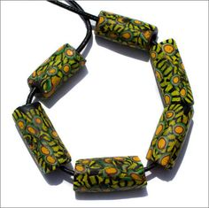 Six large antique Venetian mosaic glass trade beads in very nice conditon. They were used in the African trade in the late 1800's, early 1900's. The beads are approximately 11-12 mm in diameter and 26-31 mm in length. $49. TimeStreams.com
