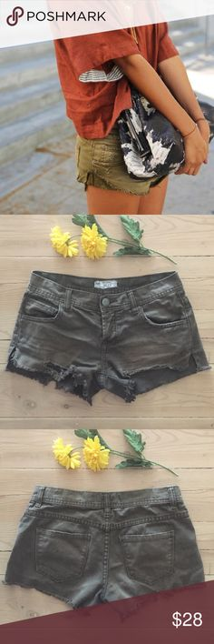 | Free People Distressed Cut Off Shorts Free People army green, distressed cut off shorts.  First photo is model wearing similar shorts.  Last three photos are shorts I'm selling.  In great, gently used condition. Free People Shorts